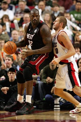PORTLAND, OR - DECEMBER 6:  Shaquille O'Neal #32 of the Miami Heat goes up against Joel Przybilla #10 of the Portland Trail Blazers during the game on December 6, 2007 at the Rose Garden in Portland, Oregon.  The Blazers won 112-106.  NOTE TO USER: User e