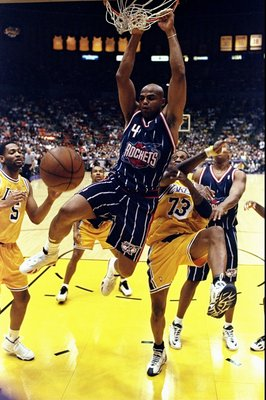 28 Feb 1999: Charles Barkley #4 of the Houston Rockets hangs from the hoop during the game against the Los Angeles Lakers at the Great Western Forum in Inglewood, California. The Lakers defeated the Rockets 106-90.    Mandatory Credit: Elsa Hasch  /Allspo