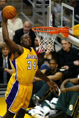 LOS ANGELES - MARCH  5:  Shaquille O'Neal #34 of the Los Angeles Lakers slam dunks during the game against the Seattle Sonics at Staples Center on March 5, 2004 in Los Angeles, California.  NOTE TO USER: User expressly acknowledges and agrees that, by dow