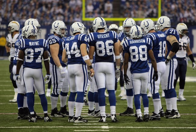 INDIANAPOLIS - JANUARY 13:  Reggie Wayne #87, Dallas Clark #44, Ben Utecht #86, Marvin Harrison #88 and Peyton Manning #18 of the Indianapolis Colts stand in the offensive huddle against the San Diego Chargers during their AFC Divisional Playoff game at t