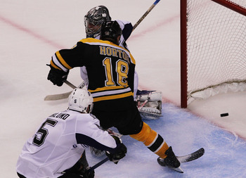 BOSTON, MA - MAY 27:  Nathan Horton #18 of the Boston Bruins scores a third period goal past Dwayne Roloson #35 of the Tampa Bay Lightning in Game Seven of the Eastern Conference Finals during the 2011 NHL Stanley Cup Playoffs at TD Garden on May 27, 2011