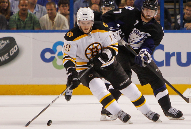 TAMPA, FL - MAY 19:  Tyler Seguin #19 of the Boston Bruins controls the puck in front of Brett Clark #7 of the Tampa Bay Lightning in Game Three of the Eastern Conference Finals during the 2011 NHL Stanley Cup Playoffs at St Pete Times Forum on May 19, 20