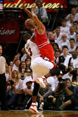 MIAMI, FL - MAY 22:  Dwyane Wade #3 of the Miami Heat attempts a shot against Derrick Rose #1 of the Chicago Bulls in Game Three of the Eastern Conference Finals during the 2011 NBA Playoffs on May 22, 2011 at American Airlines Arena in Miami, Florida.  N