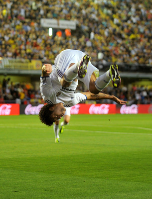 VILLARREAL, SPAIN - MAY 15:  Marcelo of Real Madrid celebrates after scoring Real's first goal during the La Liga match between Villarreal and Real Madrid at estadio El Madrigal on May 15, 2011 in Villarreal, Spain.  (Photo by Denis Doyle/Getty Images)