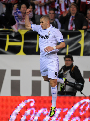 MADRID, SPAIN - MARCH 19:  Karim Benzema of Real Madrid celebrates after scoring the opening goal  during the La Liga match between Atletico Madrid and Real Madrid at Vicente Calderon Stadium on March 19, 2011 in Madrid, Spain.  (Photo by Denis Doyle/Gett