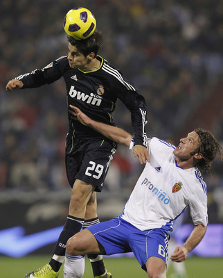 ZARAGOZA, SPAIN - DECEMBER 12: Alvaro Morataof Real Madrid jumps for a high ball with Maurizio Lanzaro of Zaragoza during the La Liga match between Real Zaragoza and Real Madrid at La Romareda stadium on December 12, 2010 in Zaragoza, Spain. (Photo by Ang