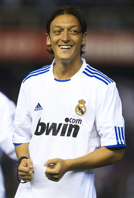 VALENCIA, BARCELONA - APRIL 20: Mesut Ozil of Real Madrid celebrates after the Copa del Rey final match between Real Madrid and Barcelona at Estadio Mestalla on April 20, 2011 in Valencia, Spain.  (Photo by Manuel Queimadelos Alonso/Getty Images)