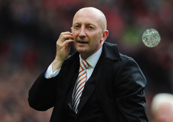 MANCHESTER, ENGLAND - MAY 22:  A dejected Ian Holloway manager of Blackpool looks on as Blackpool are relegated after the Barclays Premier League match between Manchester United and Blackpool at Old Trafford on May 22, 2011 in Manchester, England.  (Photo
