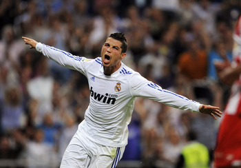 MADRID, SPAIN - MAY 21:  Cristiano Ronaldo of Real Madrid celebrates after scoring his 2nd goal during the La Liga match between Real Madrid and UD Almeria at Estadio Santiago Bernabeu on May 21, 2011 in Madrid, Spain.  (Photo by Denis Doyle/Getty Images)