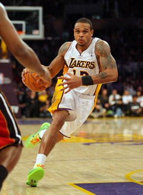LOS ANGELES, CA - DECEMBER 25:  Shannon Brown #12 of the Los Angeles Lakers makes a move to the basket against the Miami Heat during the NBA game at Staples Center on December 25, 2010 in Los Angeles, California. The Heat defeated the Lakers 96-80.  NOTE