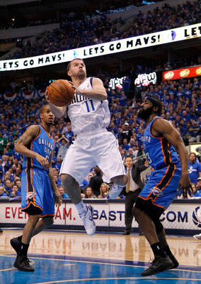 DALLAS, TX - MAY 17:  Jose Juan Barea #11 of the Dallas Mavericks goes up for a shot against James Harden #13 of the Oklahoma City Thunder in Game One of the Western Conference Finals during the 2011 NBA Playoffs at American Airlines Center on May 17, 201