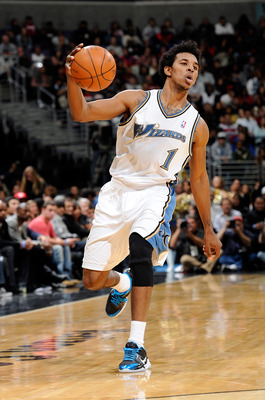 WASHINGTON, DC - DECEMBER 18:  Nick Young #1 of the Washington Wizards handles the ball against the Miami Heat at the Verizon Center on December 18, 2010 in Washington, DC. NOTE TO USER: User expressly acknowledges and agrees that, by downloading and or u