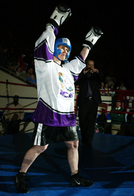 INDIANAPOLIS, IN - MARCH 12:  Tonya Harding enters the ring for a boxing exhibition during the second period intermission at the Colorado Eagles versus Indianapolis Ice hockey game at the Pepsi Coliseum on March 12, 2004 in Indianapolis, Indiana. (Photo b