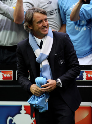 LONDON, ENGLAND - MAY 14:  Roberto Mancini smiles after his Manchester City team won the FA Cup sponsored by E.ON Final match between Manchester City and Stoke City at Wembley Stadium on May 14, 2011 in London, England.  (Photo by Alex Livesey/Getty Image