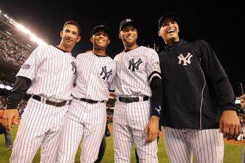 NEW YORK - SEPTEMBER 21:  Jorge Posada, Mariano Rivera, Derek Jeter, and Andy Pettitte of the New York Yankees pose on the pitchers mound after winning the last regular season game at Yankee Stadium 7-3 against the Baltimore Orioles on September 21, 2008