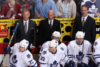 GLENDALE, AZ - JANUARY 13:  Coaches Ron Wilson, Keith Acton and Rob Zettler of the Toronto Maple Leafs during the NHL game against the Phoenix Coyotes at Jobing.com Arena on January 13, 2011 in Glendale, Arizona. The Coyotes defeated the Maple Leafs 5-1.