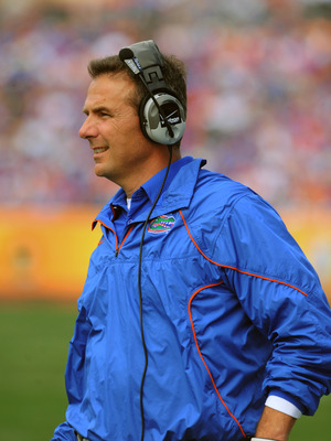 TAMPA, FL - JANUARY 1:  Coach Urban Meyer of the Florida Gators directs play against the Penn State Nittany Lions January 1, 2010 in the 25th Outback Bowl at Raymond James Stadium in Tampa, Florida.  (Photo by Al Messerschmidt/Getty Images)