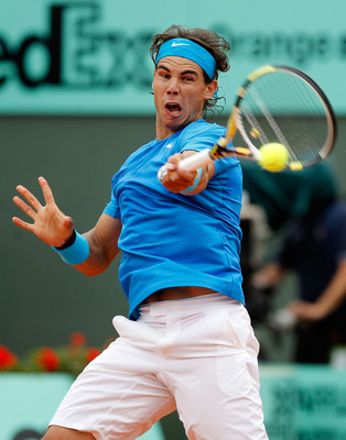 PARIS, FRANCE - MAY 30:  Rafael Nadal of Spain hits a forehand during the men's singles round four match between Rafael Nadal of Spain and Ivan Lubicic of Croatia on day nine of the French Open at Roland Garros on May 30, 2011 in Paris, France.  (Photo by