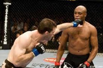Anderson Silva defending punches