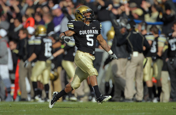 BOULDER, CO - NOVEMBER 20:  Running back Rodney Stewart #5 of the Colorado Buffaloes celebrates after he threw an option pass 23 yards to Toney Clemons for a touchdown against the Kansas State Wildcats at Folsom Field on November 20, 2010 in Boulder, Colo