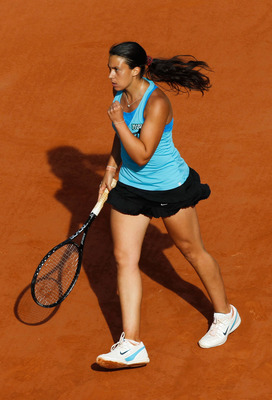 PARIS, FRANCE - MAY 29:  Marion Bartoli of France celebrates a point during the women's singles round four match between Gisela Dulko of Argentina and Marion Bartoli of France on day eight of the French Open at Roland Garros on May 29, 2011 in Paris, Fran