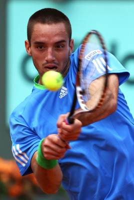 PARIS, FRANCE - MAY 31:  Viktor Troicki of Serbia hits a backhand during the men's singles round four match between Andy Murray of Great Britain and Viktor Troicki of Serbia on day ten of the French Open at Roland Garros on May 31, 2011 in Paris, France.