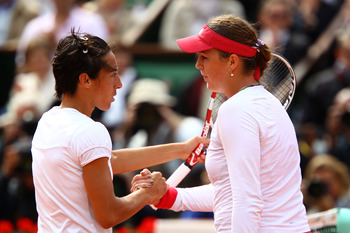 PARIS, FRANCE - MAY 31:  Francesca Schiavone of Italy shakes hands with Anastasia Pavlyuchenkova of Russia following her victory during the women's singles quarterfinal match between Anastasia Pavlyuchenkova of Russia and Francesca Schiavone of Italy on d