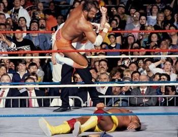 Randy Savage landing his trademark elbow on Hulk Hogan