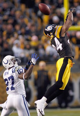 PITTSBURGH - NOVEMBER 9:  Ike Taylor #24 of the Pittsburgh Steelers leaps to deflects the pass to Reggie Wayne #87 of the Indianapolis Colts on November 9, 2008 at Heinz Field in Pittsburgh, Pennsylvania. (Photo by: Rick Stewart/Getty Images)