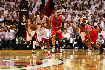 MIAMI, FL - MAY 24: Mario Chalmers #15 of the Miami Heat pushes the ball up court against the Chicago Bulls in Game Four of the Eastern Conference Finals during the 2011 NBA Playoffs on May 24, 2011 at American Airlines Arena in Miami, Florida. The Heat w