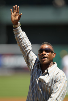 OAKLAND, CA - APRIL 30:  Rickey Henderson waves to the crowd after he threw out the ceremonial first pitch before the Oakland Athletics' game against the Texas Rangers at Oakland-Alameda County Coliseum on April 30, 2011 in Oakland, California.  (Photo by