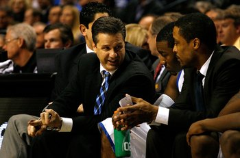 NASHVILLE, TN - MARCH 13:  (L-R) Head coach John Calipari, John Wall #11 and assistant coach Rod Strickland of the Kentucky Wildcats talk on the bench against the Tennessee Volunteers during the semifinals of the SEC Men's Basketball Tournament at the Bri
