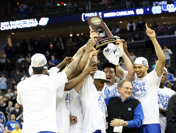 NEWARK, NJ - MARCH 27:  The Kentucky Wildcats pose with the trophy after defeating the North Carolina Tar Heels in the east regional final of the 2011 NCAA men's basketball tournament at Prudential Center on March 27, 2011 in Newark, New Jersey.  (Photo b