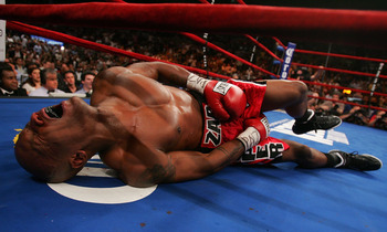 NEW YORK - JUNE 9: Zab Judah lays in agony on the canvas after being hit by a second low blow by Miguel Cotto of Puerto Rico during their WBA Welterweight Championship bout on June 9, 2007 at Madison Square Garden in New York City. (Photo by Nick Laham/Ge