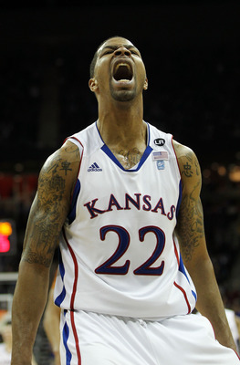 KANSAS CITY, MO - MARCH 12:  Marcus Morris #22 of the Kansas Jayhawks reacts after a dunk against the Texas Longhorns in the second half of the 2011 Phillips 66 Big 12 Men's Basketball Tournament championship game against the Kansas Jayhawks at Sprint Cen