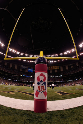 NEW ORLEANS - OCTOBER 04:  A pad protecting the field goal posts has a pink ribbon supporting Breast Cancer Awareness on the field before the New Orleans Saints play the New York Jets at the Louisana Superdome on October 4, 2009 in New Orleans, Louisiana.