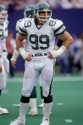 SEPTEMBER - 1988:  Defensive end Mark Gastineau #99 of the New York Jets looks on from the sidelines during a game circa September of 1988.  (Photo by Scott Halleran/Getty Images)