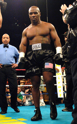 WASHINGTON - JUNE 11:  Mike Tyson enters the ring before the start of his heavyweight fight against Kevin McBride at the MCI Center June 11, 2005 in Washington, DC.  (Photo by Mitchell Layton/Getty Images)