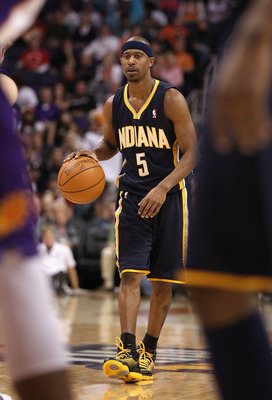 PHOENIX - DECEMBER 03:  T.J. Ford #5 of the Indiana Pacers handles the ball during the NBA game against the Phoenix Suns at US Airways Center on December 3, 2010 in Phoenix, Arizona.  The Suns defeated the Pacers 105-97.  NOTE TO USER: User expressly ackn