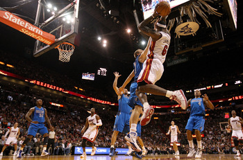 MIAMI, FL - DECEMBER 20:  LeBron James #6 of the Miami Heat passes over Dirk Nowitzki #41 of the Dallas Mavericks  during a game at American Airlines Arena on December 20, 2010 in Miami, Florida. NOTE TO USER: User expressly acknowledges and agrees that,