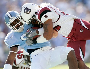 CHAPEL HILL, NC - OCTOBER 13:  Emanuel Cook #21 of the South Carolina Gamecocks tackles Hakeem Nicks #88 of the North Carolina Tar Heels in the first quarter at Kenan Stadium October 13, 2007 in Chapel Hill, North Carolina.  (Photo by Grant Halverson/Gett