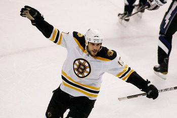 TAMPA, FL - MAY 25:  Milan Lucic #17 of the Boston Bruins celebrates his first period goal against the Tampa Bay Lightning in Game Six of the Eastern Conference Finals during the 2011 NHL Stanley Cup Playoffs at St Pete Times Forum on May 25, 2011 in Tamp
