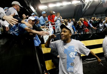 DETROIT - APRIL 06:  Wayne Ellington #22 of the North Carolina Tar Heels celebrates with fans as he run off the court after the Tar Heels 89-72 win against the Michigan State Spartans during the 2009 NCAA Division I Men's Basketball National Championship