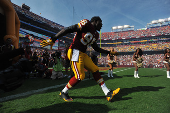 LANDOVER - SEPTEMBER 19:  Brian Orakpo #98 of the Washington Redskins is introduced before the game against the Houston Texans at FedExField on September 19, 2010 in Landover, Maryland. The Texans defeated the Redskins in overtime 30-27. (Photo by Larry F