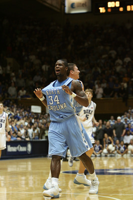 DURHAM, NC - MARCH 4:  David Noel #34 of the University of North Carolina at Chapel Hill Tar Heels celebrates during the game against the Duke University Blue Devils on March 4, 2006 at Cameron Indoor Stadium in Durham, North Carolina. North Carolina won