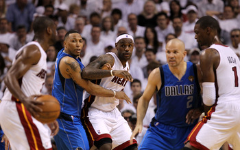 MIAMI, FL - MAY 31:  Dwyane Wade #3 of the Miami Heat looks to pass the ball to LeBron James as CHris Bosh #1 (R) sets a screen against Jason Kidd #2 of the Dallas Mavericks as Shawn Marion (2nd L) #0 of the Mavericks defends James in Game One of the 2011