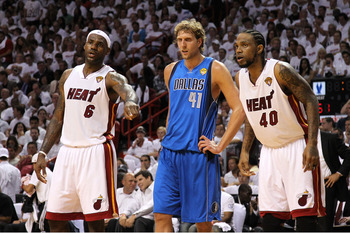 MIAMI, FL - MAY 31:  LeBron James #6 (L) and Udonis Haslem #40 of the Miami Heat look on as they Dirk Nowitzki #41 of the Dallas Mavericks stands between them as they await a free throw attempt in Game One of the 2011 NBA Finals at American Airlines Arena
