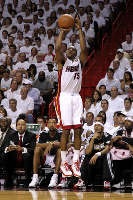 MIAMI, FL - MAY 31:  Mario Chalmers #15 of the Miami Heat attempts a shot against the Dallas Mavericks in Game One of the 2011 NBA Finals at American Airlines Arena on May 31, 2011 in Miami, Florida. NOTE TO USER: User expressly acknowledges and agrees th