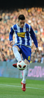 BARCELONA, SPAIN - MAY 08: Jose Callejon (R) of Espanyol passes the ball beside Andreu Fontas of Barcelona during the La Liga match between Barcelona and Espanyol at Nou Camp on May 8, 2011 in Barcelona, Spain.  (Photo by Denis Doyle/Getty Images)