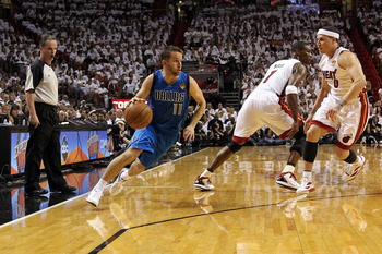 MIAMI, FL - MAY 31:  Jose Juan Barea #11 of the Dallas Mavericks drives against Chris Bosh #1 and Mike Bibby #0 of the Miami Heat in Game One of the 2011 NBA Finals at American Airlines Arena on May 31, 2011 in Miami, Florida. NOTE TO USER: User expressly